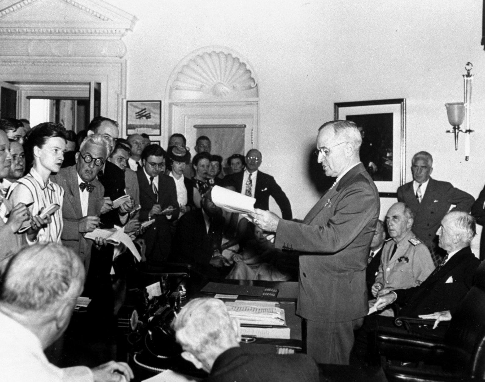 FILE - In this Tuesday, Aug. 14, 1945 picture, U.S. President Harry S. Truman stands at his desk during a news conference in the White House in Washington announcing the Japanese surrender, officially signaling the war's end.  World War II veterans, their families and officials marked the 65th anniversary of the end of that war on board the same ship where Japan formally surrendered in 1945.  (AP Photo/File)
