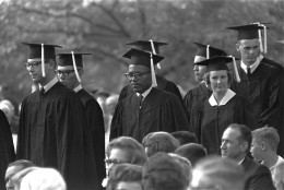 With a tight grin fixed on his face, James H. Meredith stands in line with fellow students awaiting presentation of diplomas at graduation ceremonies, August 19, 1963, at the University of Mississippi at Oxford.  Meredith became the first black man to get a degree from Ole Mississippi.  (AP Photof)