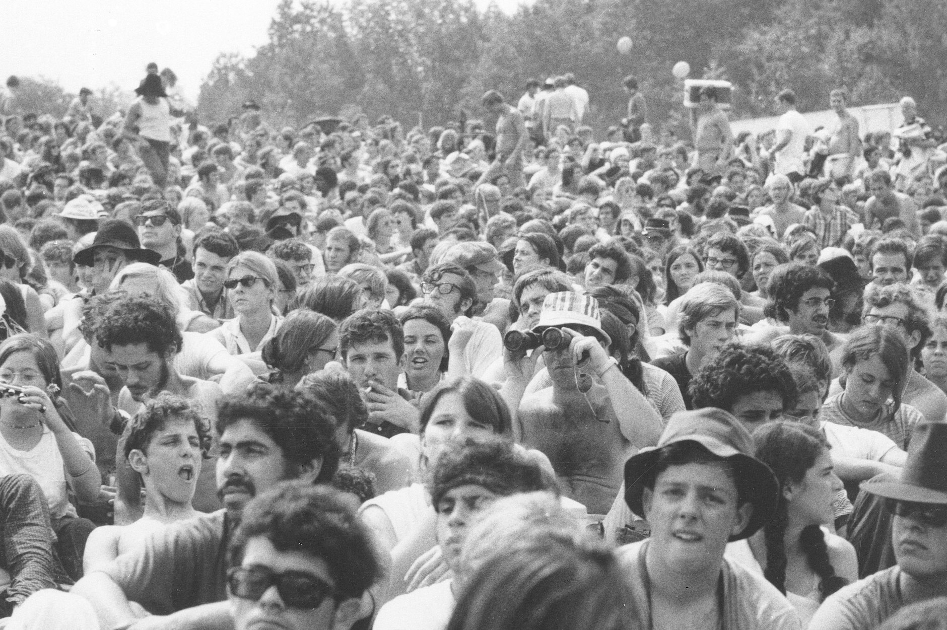 """This is a view of part of the crowd at the Woodstock Music and Arts Festival held on a 600-acre pasture in the Catskill Mountains near White Lake in Bethel, N.Y., in Aug. 1969.  The festival, billed as """"Thee Days of Peace and Music,"""" started on Friday, Aug. 15.  More than 450,000 persons attended.  (AP Photo)"""