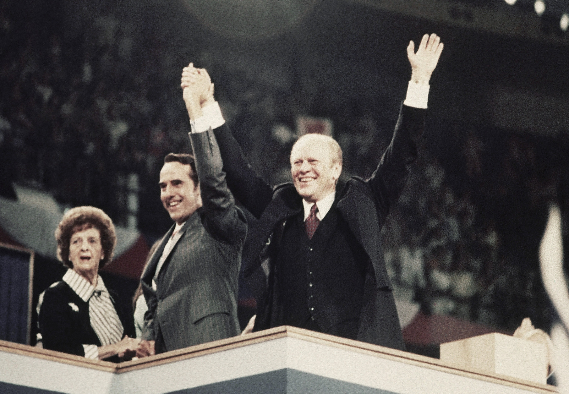 Sen. Robert Dole, center, his mother Bina Dole, left, and Pres. Gerald Ford shown on the final night of the Republican National Convention in Kemper Arena, Aug. 19, 1976, Kansas City, Mo. (AP Photo)