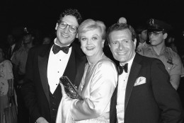 """Actress Angela Lansbury, center, poses with actor-author Harvey Fierstein, left, and composer-Lyricist Jerry Herman, Sunday, August 21, 1983 in New York at the Broadway opening party for the play """"La Cage Aux Folles."""" Fierstein wrote the book """"La Cage Aux Folles"""", and Herman authored the music and Lyrics for the Broadway musical """"Mame'. (AP Photo/Rene Perez)"""