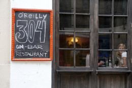 """Tourists eat at the paladar O'Reilly 304 in Old Havana, Cuba, Monday, June 1, 2015. When eating in Havana, stick to """"paladares"""" - privately owned restaurants. You'll need reservations for the best. Prices are moderate but not cheap. (AP Photo/Desmond Boylan)"""
