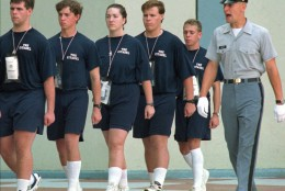 On this date in 1995, Shannon Faulkner officially became the first female cadet in the history of The Citadel, South Carolina's state military college. Here, Faulkner, center, marches with her company on Monday, Aug. 14, 1995. (AP Photo/Wade Spees, Pool)