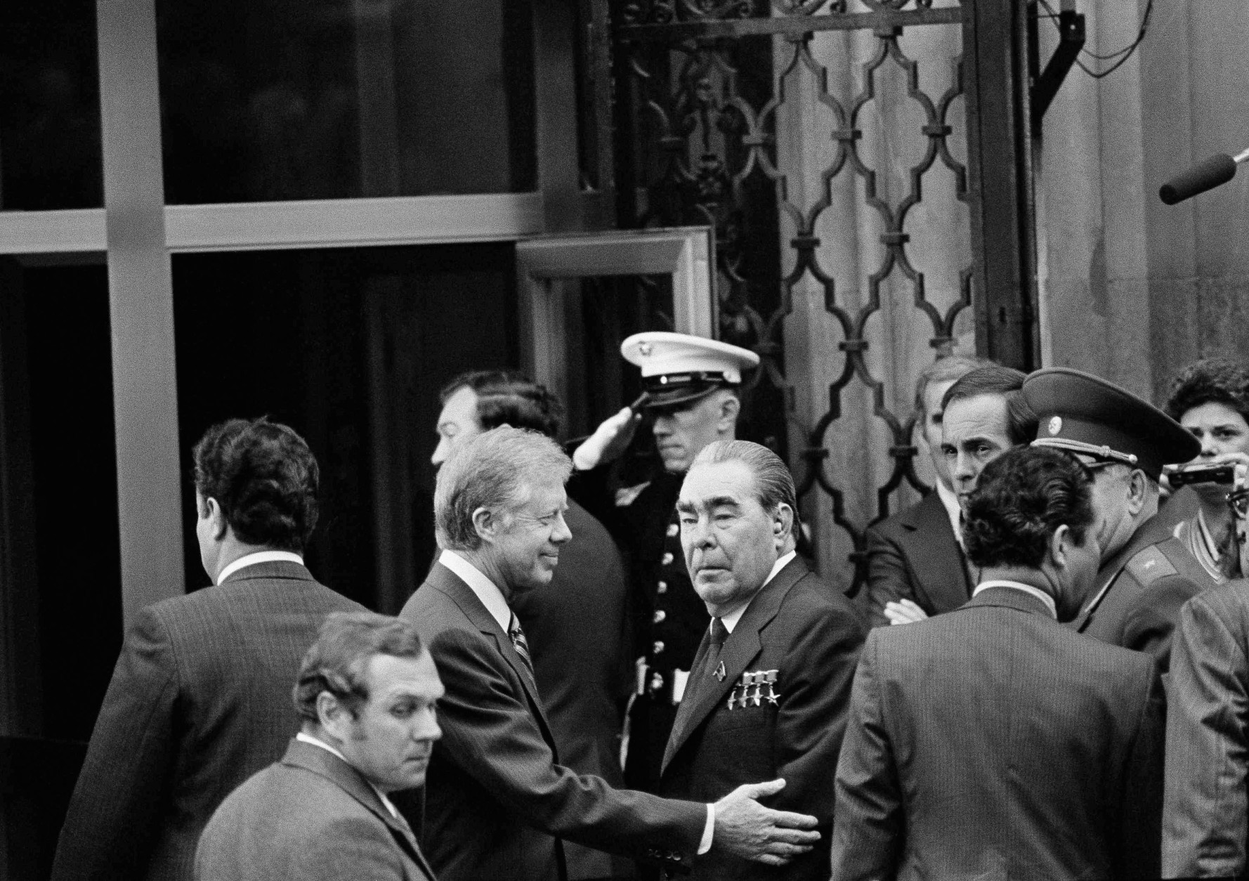 FILE - In this Monday, June 18, 1979 file photo, U.S. President Jimmy Carter, center left, smiles as he walks with Soviet President Leonid Brezhnev, center, outside the U.S. embassy in Vienna, Austria for private talks before heading to the Imperial Hofburg Palace to sign the SALT II  nuclear treaty. On Wednesday, Aug. 12, 2015, Carter announced he has cancer and will undergo treatment at an Atlanta hospital. (AP Photo)