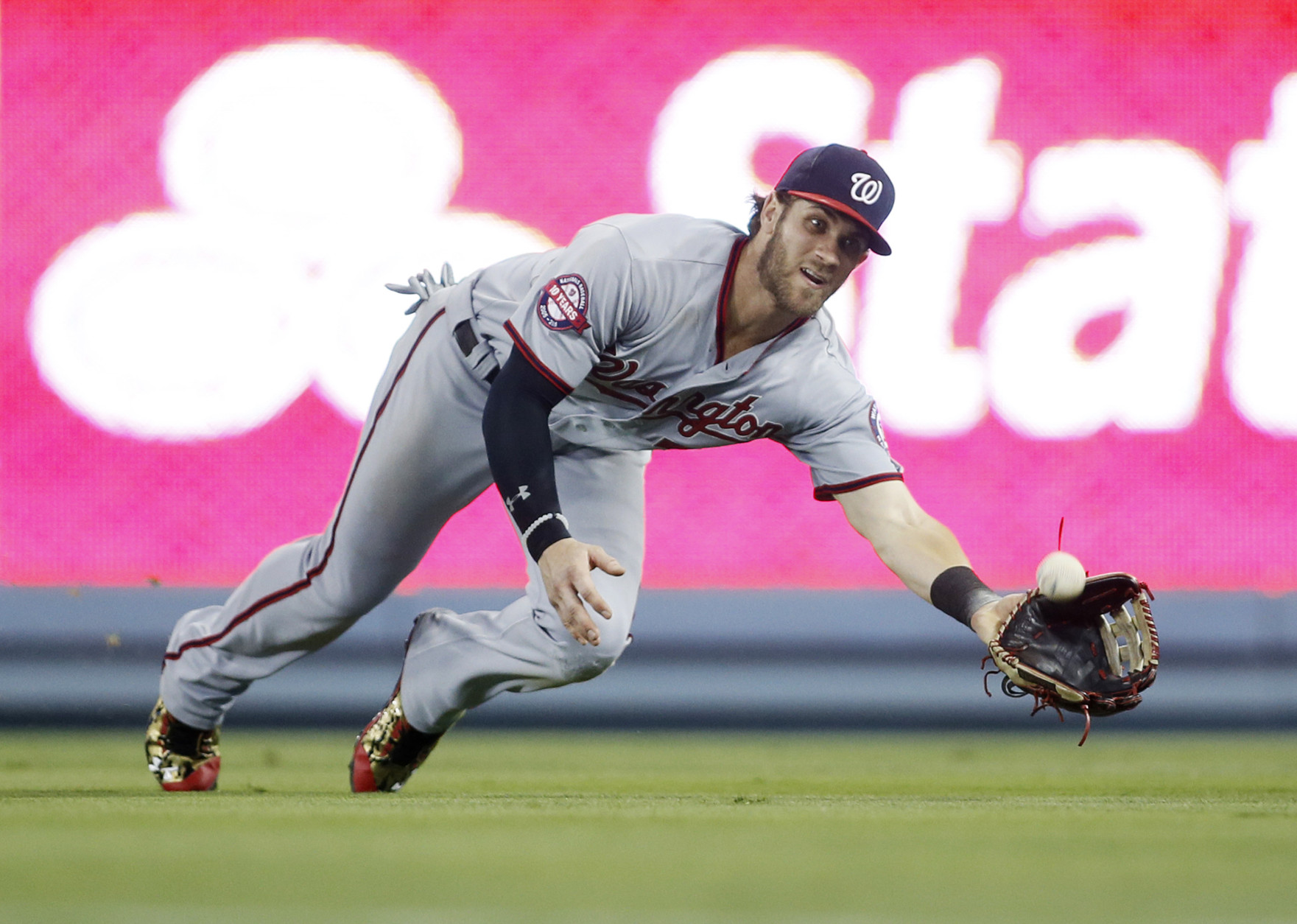 Bryce Harper made a great tumbling catch in cleats he wore ...