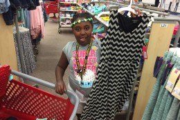 """Nazariah Galloway will be in the fourth grade. She's showing off a bold dark patterned dress, but says, """"I like colors."""" (WTOP/Kristi King)"""