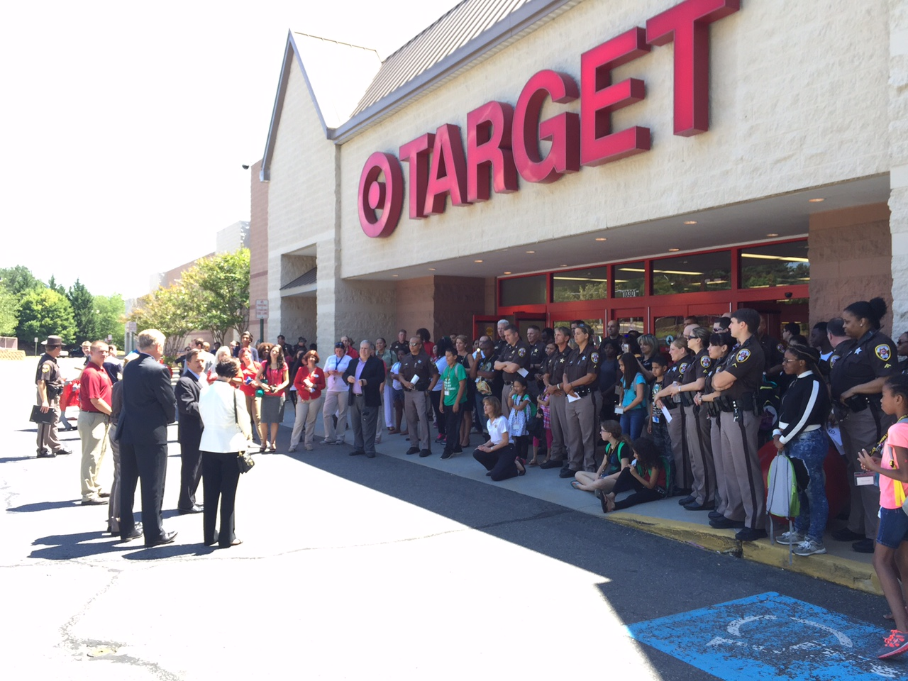 At the Burke, Virginia, Target, 40 children being treated to a shopping spree are from Katherine K. Hanley Family Shelter in Fairfax, Patrick Henry Family Shelter in Falls Church and Next Steps Family Shelter in Alexandria. (WTOP/Kristi King)
