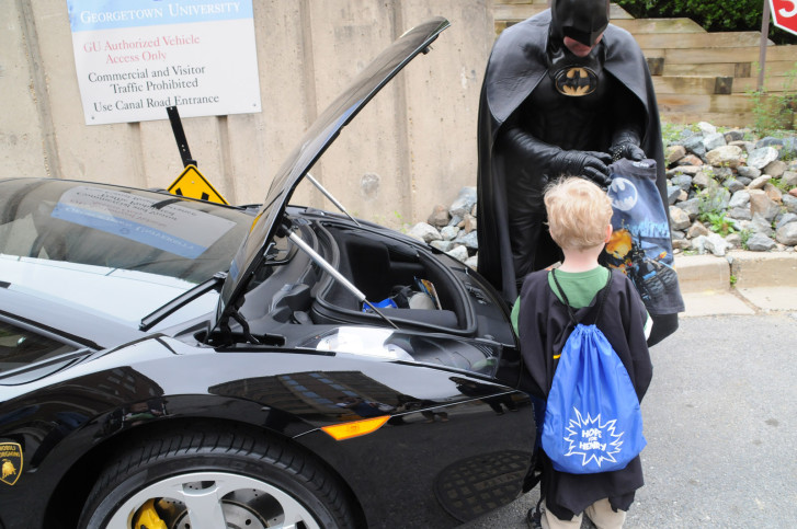 Good batman mobile henry Lenny Robinson dressed as Batman passes out goodies to a patient at the annual Hope for Henry Superhero Celebration for kids at