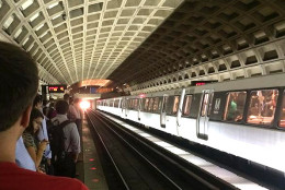 Metro riders crowd onto the platform at Farragut West waiting for a spot on a packed train. (WTOP/Mike Murillo)