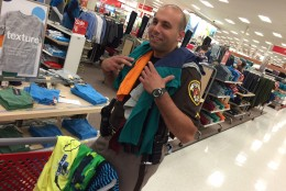 """Deputy Josh Hyatt's child, who prefers not to be pictured, says Hyatt is a good helper because """"he knows how to pick good clothes."""" adding with a giggle, """"he has good style."""" (WTOP/Kristi King)"""