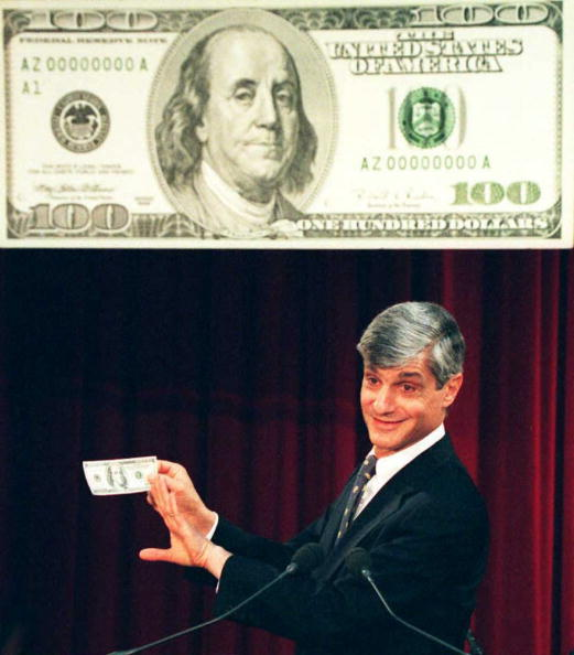 NEW YORK, NY - MARCH 25:  US Secretary of the Treasury Robert Rubin holds up a new US 100 dollar bill during a news conference 25 March at the Federal Reserve Bank in New York. In the first major change to US currency since 1929, the new bill is designed to thwart counterfeiters.  (Photo credit should read DON EMMERT/AFP/Getty Images)
