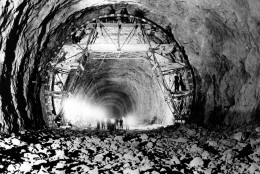 On this date in 1936, Boulder Dam (now Hoover Dam) began operation as President Franklin D. Roosevelt pressed a key in Washington to signal the startup of the dam's first hydroelectric generator. This view shows the interior of one of the tunnels through which the Colorado River would be diverted around the Hoover Dam site in Boulder City, Nev., April 18, 1932.  (AP Photo)