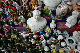 On this date in 1976, Communist Chinese leader Mao Zedong died in Beijing at age 82. Here, a ceramic bust of late Chairman Mao  Zedong sits among other  statues at a market   in Beijing, China Saturday Sept. 9, 2006.  (AP Photo/Elizabeth Dalziel)