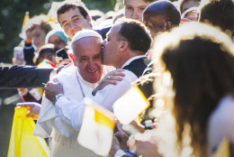 CROP OF DCCO110 * Pope Francis is kissed by a well-wisher as he departs the Apostolic Nunciature, the Vatican's diplomatic mission in the heart of Washington, Wednesday, Sept. 23, 2015. Pope Francis will visit the White House, becoming only the third pope to visit the White House.  (AP Photo/Cliff Owen)