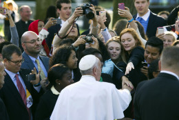 Pope Francis greets well-wishers as he departs the Apostolic Nunciature, the Vatican's diplomatic mission inWashington, Wednesday, Sept. 23, 2015. Pope Francis will visit the White House where President Barack Obama will host a state arrival ceremony.  (AP Photo/Cliff Owen)