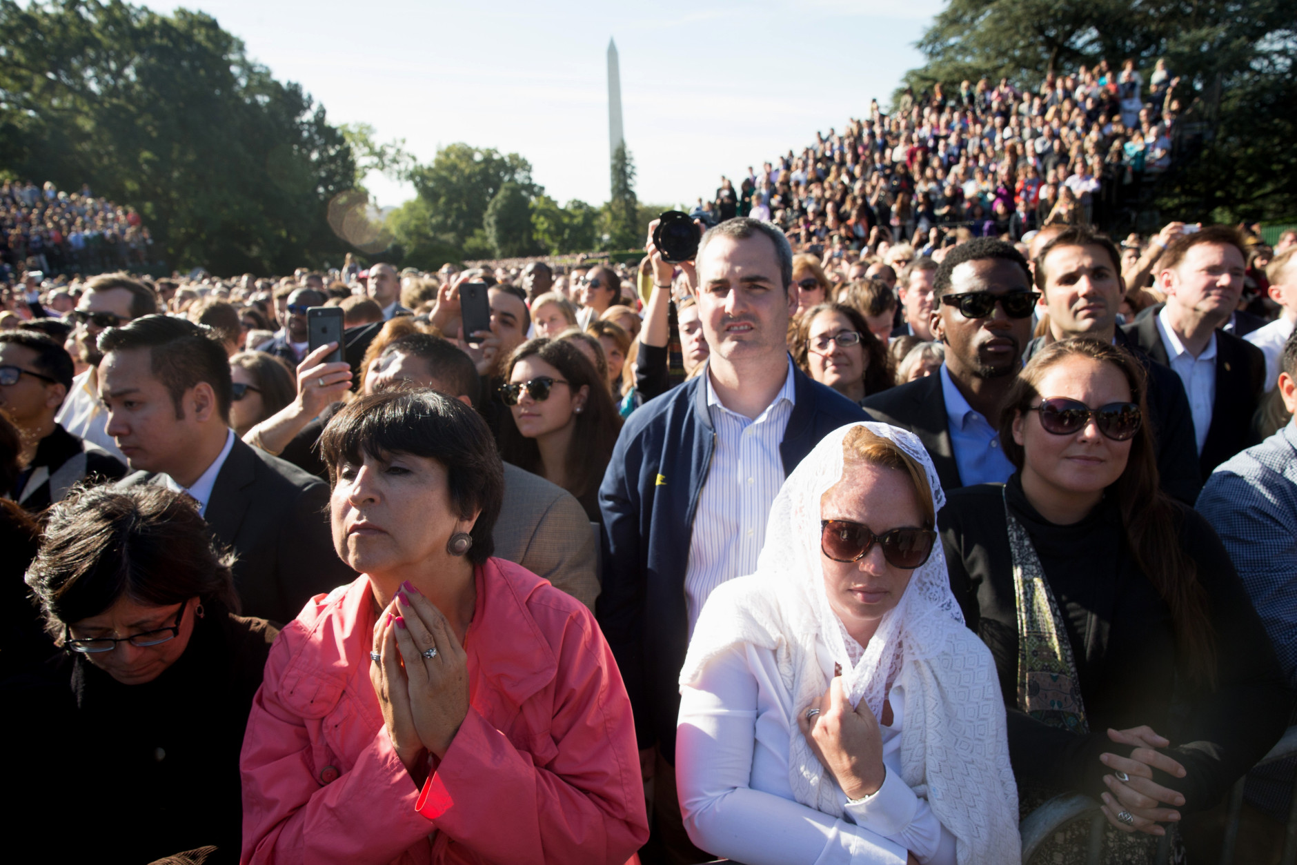 Guests listen as President Barack Obama and Pope Francis speak during a state arrival ceremony for the pope, Wednesday, Sept. 23, 2015, on the South Lawn of the White House in Washington. (AP Photo/Andrew Harnik)