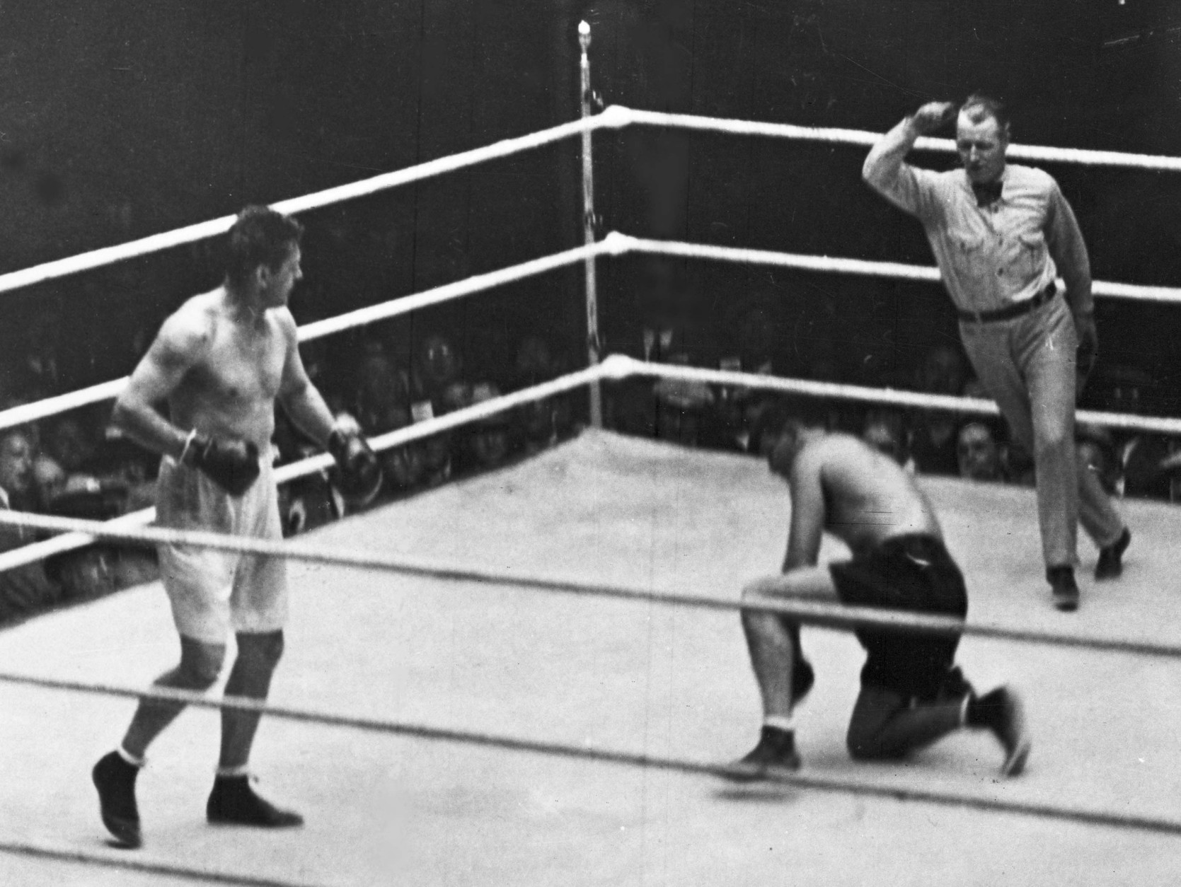 "On this date in 1927, Gene Tunney successfully defended his heavyweight boxing title against Jack Dempsey in the famous ""long-count"" fight in Chicago. (AP Photo)"