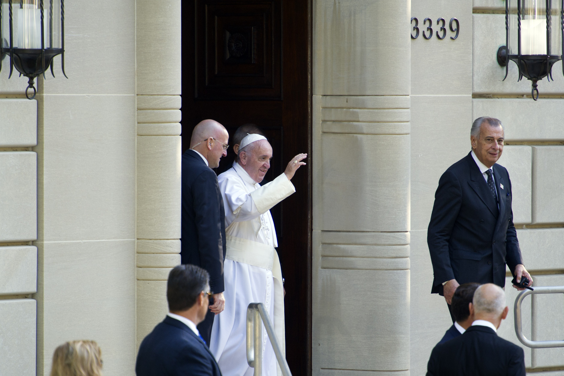 Pope Francis waves as he departs the Apostolic Nunciature, the Vatican's diplomatic mission in Washington, Wednesday, Sept. 23, 2015, for the White House where President Barack Obama will host a state arrival ceremony.  (AP Photo/Cliff Owen)