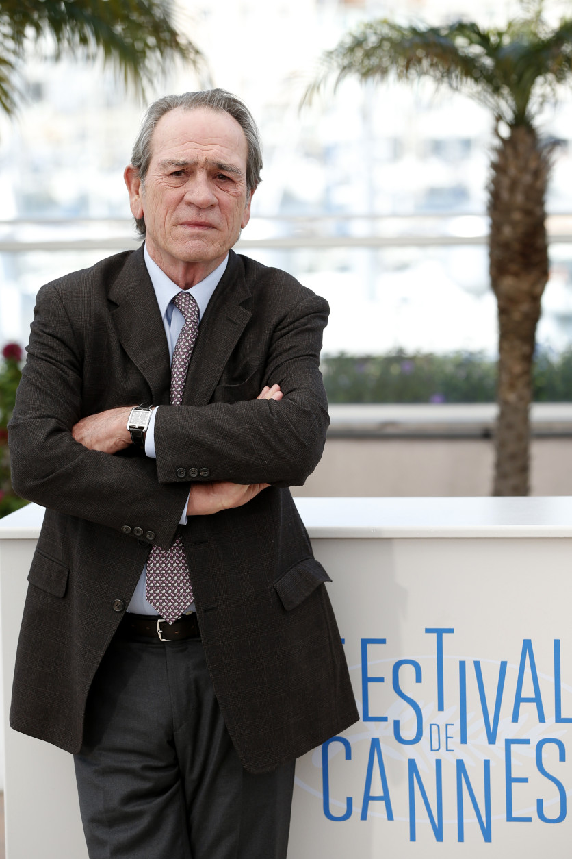 Actor Tommy Lee Jones is 69 on Sept. 15. Here, Jones poses for photographers during a photo call for The Homesman at the 67th international film festival, Cannes, southern France, Sunday, May 18, 2014. (AP Photo/Alastair Grant)