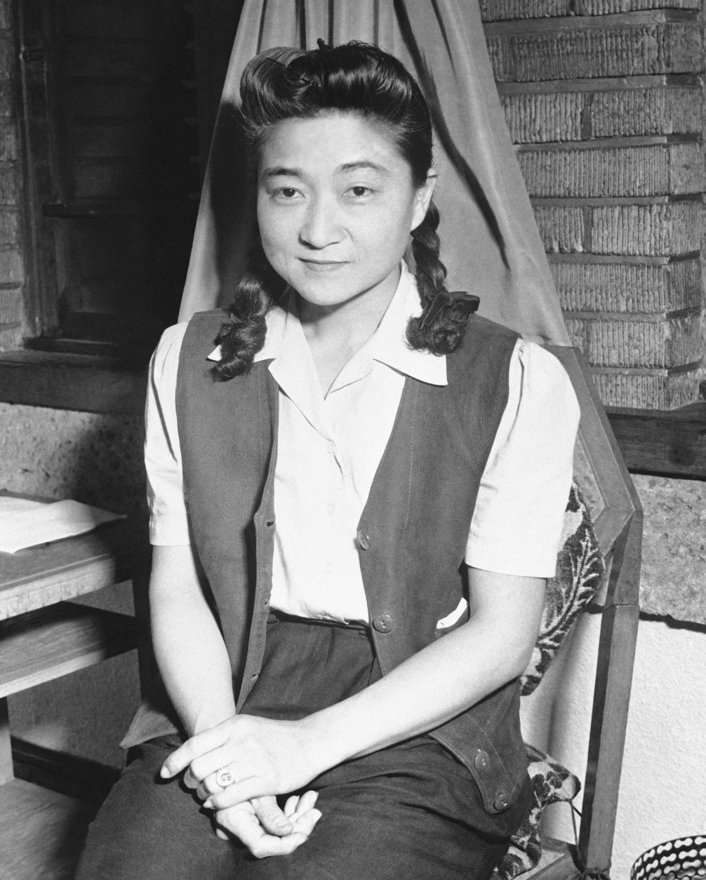 Iva Iuka Toguri, 30-year-old graduate of the University of California, known to thousands of  soldiers in the Pacific area as Tokyo Rose through her propaganda broadcasts for the Japanese.   She rests after an interview on Sept. 5, 1945 in Tokyo following her capture by American Forces.  (AP Photo/pool)