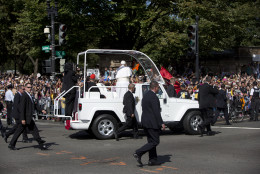 Pope Francis waves to the crowd from his popemobile at the corner of Constitution Avenue and 15th Street NW, during a parade around the Ellipse near the White House in Washington, Wednesday, Sept. 23, 2015. (AP Photo/Carolyn Kaster)