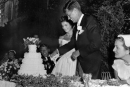 U.S. Senator John F. Kennedy, D-Mass., and his bride, the former Jacqueline Lee Bouvier, cut their wedding cake during a reception following thier marriage Sept.12, 1953 at Newport, R.I.  (AP Photo)