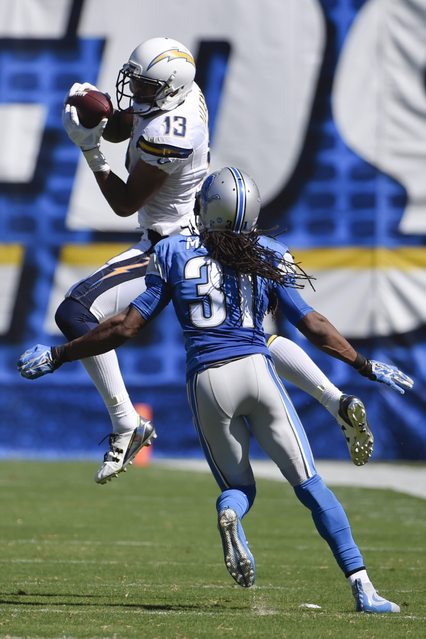 San Diego Chargers wide receiver Keenan Allen (13) hauls in a pass as Detroit Lions cornerback Rashean Mathis defends during the second half of an NFL football game Sunday, Sept. 13, 2015, in San Diego. (AP Photo/Denis Poroy)