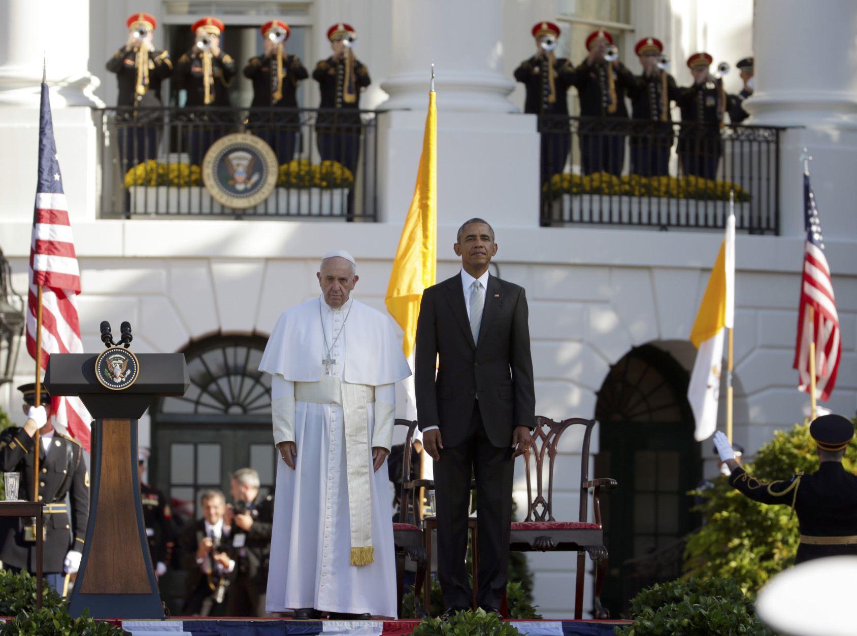 President Barack Obama and Pope Francis stand at attention during the playing of the national anthems during a state arrival ceremony for the pope, Wednesday, Sept. 23, 2015, on the South Lawn of the White House in Washington. (AP Photo/Pablo Martinez Monsivais)