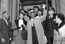 The Rev. Dr. Martin Luther King Jr., of Alabama, waves to the nearly 500 people waiting outside Harlem hospital in New York City on Oct. 3, 1958.  Dr. King was stabbed on Sept. 20.  (AP Photo)