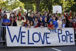 People cheer before a parade for Pope Francis, Wednesday, Sept. 23, 2015, in Washington. (AP Photo/Alex Brandon, Pool)