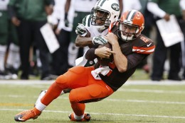 New York Jets defensive back Buster Skrine (41) tackles Cleveland Browns' Johnny Manziel (2) during the second half of an NFL football game Sunday, Sept. 13, 2015 in East Rutherford, N.J. The Jets won 31-10. (AP Photo/Kathy Willens)