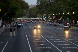 People position along a cleared Constitution Avenue along the Pope Francis parade route near the White House in Washington, Wednesday, Sept. 23, 2015. (AP Photo/Carolyn Kaster)