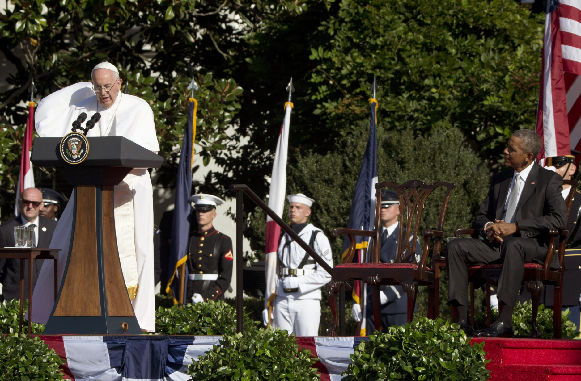 Pope Francis talks as President Barack Obama listens during a state arrival ceremony on the South Lawn of the White House in Washington, Wednesday, Sept. 23, 2015. (AP Photo/Alessandra Tarantino)