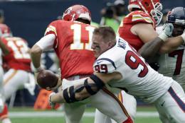 Houston Texans' J.J. Watt (99) sacks Kansas City Chiefs' Alex Smith (11) during the first half of an NFL football game Sunday, Sept. 13, 2015, in Houston. (AP Photo/David J. Phillip)
