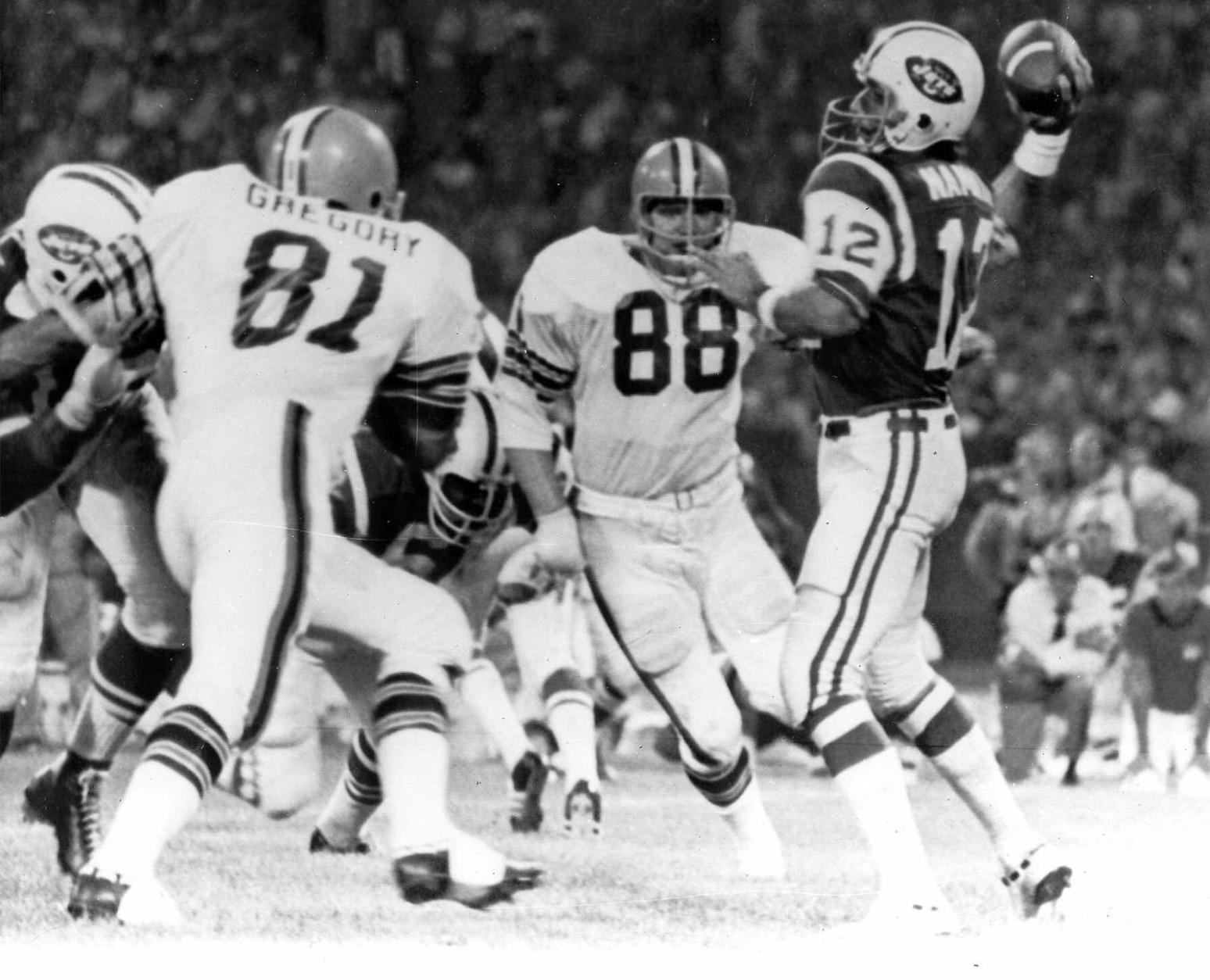 Cleveland Browns defensive ends Jack Gregory (81) and Ron Snidow (88) blast through the New York Jets protection and nab quarterback Joe Namath in the second quarter of their game in Cleveland, Ohio Sept 21, 1970. (AP Photo)
