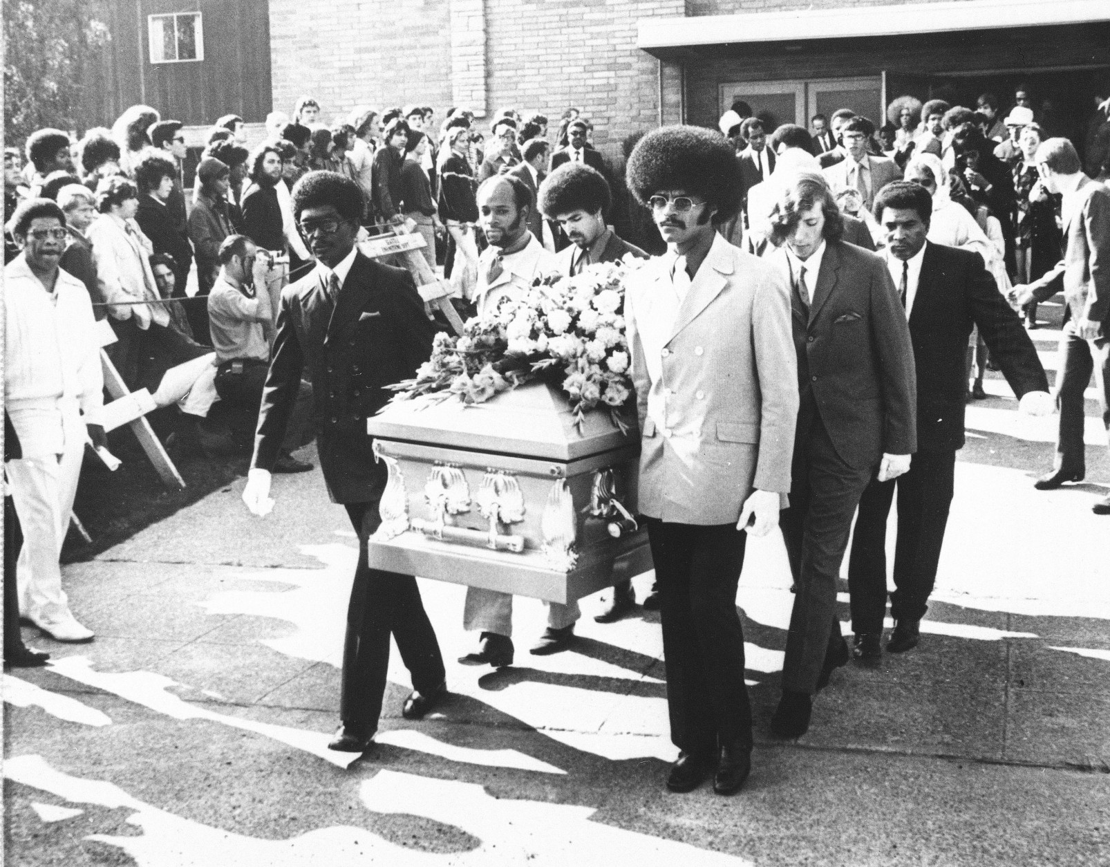On this date in 1970, rock star Jimi Hendrix died in London at age 27. Here, friends of Hendrix carry his coffin from the church after funeral services, Oct. 1, 1970 in Seattle. (AP Photo/Barry Sweet)