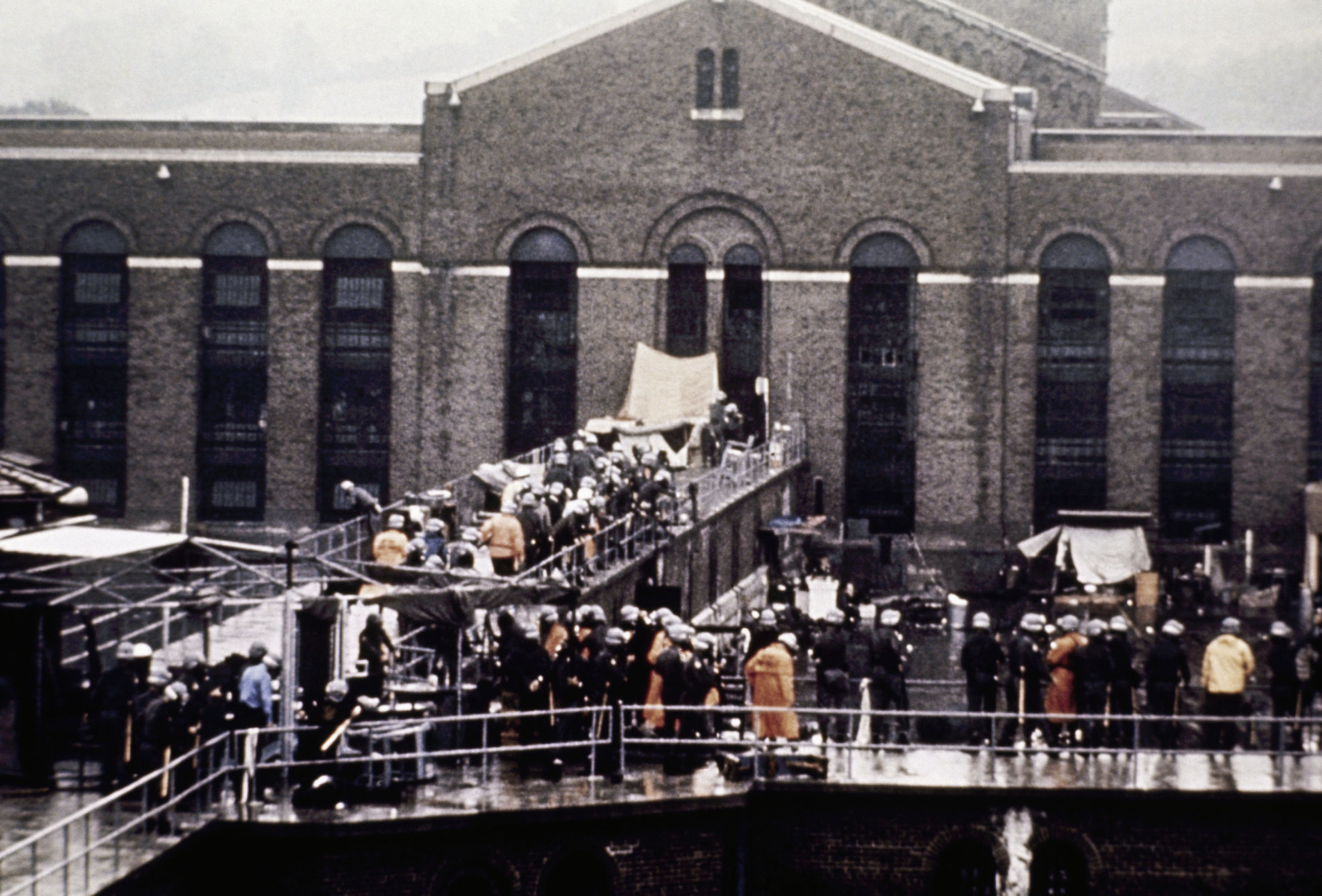 On this date in 1971, prisoners seized control of the maximum-security Attica Correctional Facility near Buffalo, New York, beginning a siege that ended up claiming 43 lives. Here, shotgun carrying New York State troopers and prison guards mill outside Attica State Prison on Sept. 13, 1971. (AP Photo)