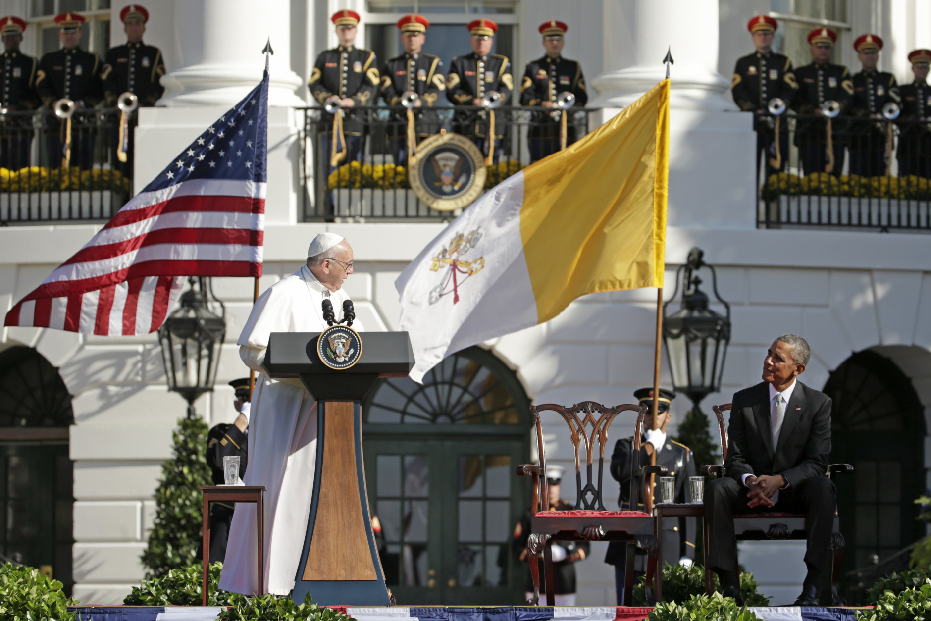 Pope Francis turns toward President Barack Obama during his welcoming remarks at the state arrival ceremony in his honor on the South Lawn of the White House in Washington, Wednesday, Sept. 23, 2015. (AP Photo/Pablo Martinez Monsivais)