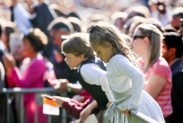 Young members of the audience stand on the South Lawn of the White House in Washington, Wednesday, Sept. 23, 2015, during a state arrival ceremony for the Pope Francis. (AP Photo/Andrew Harnik)