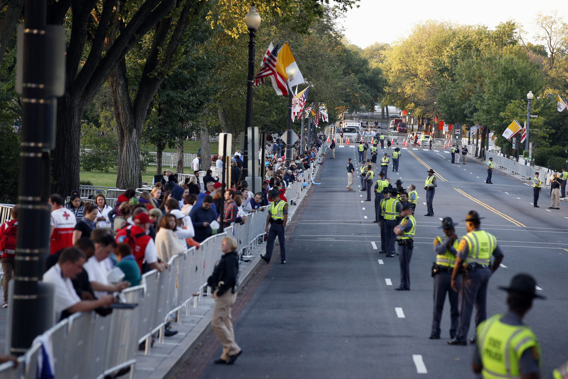 People and security line the parade route on 17th Street looking toward Constitution Avenue for Pope Francis, Wednesday, Sept. 23, 2015, in Washington. The parade will take place after President Barack Obama welcomes him at the White House. (AP Photo/Alex Brandon, Pool)
