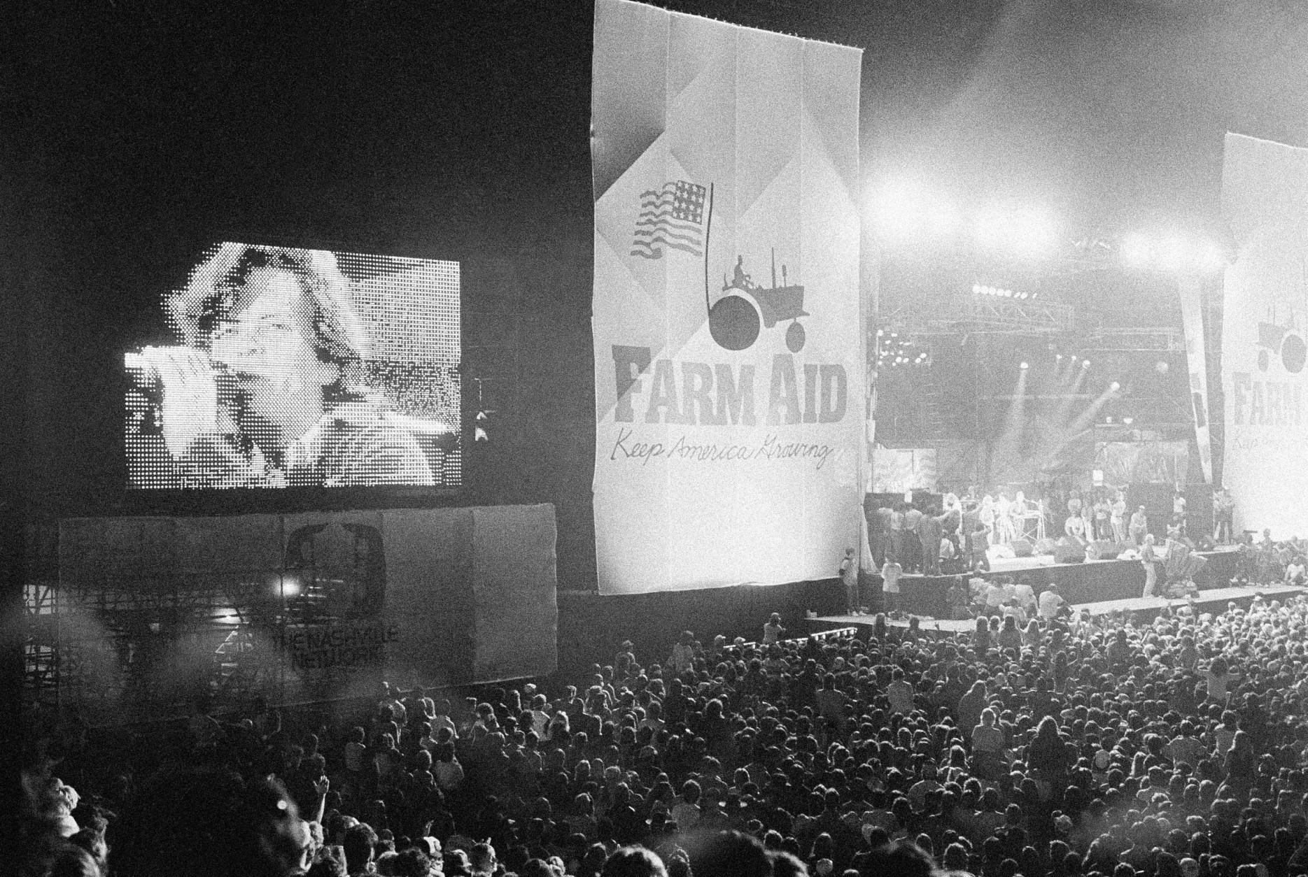 "On this date in 1985, rock and country music artists participated in ""Farm Aid,"" a concert staged in Champaign, Illinois, to help the nation's farmers. Here, John Cougar Mellencamp performs.  (AP Photo/Seth Perlman)"