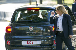 A Secret Service Agent looks on as Pope Francis departs the Apostolic Nunciature, the Vatican's diplomatic mission in the heart of Washington, in a Fiat 500L,  Wednesday, Sept. 23, 2015. Pope Francis will visit the White House, becoming only the third pope to visit the White House.  (AP Photo/Cliff Owen)