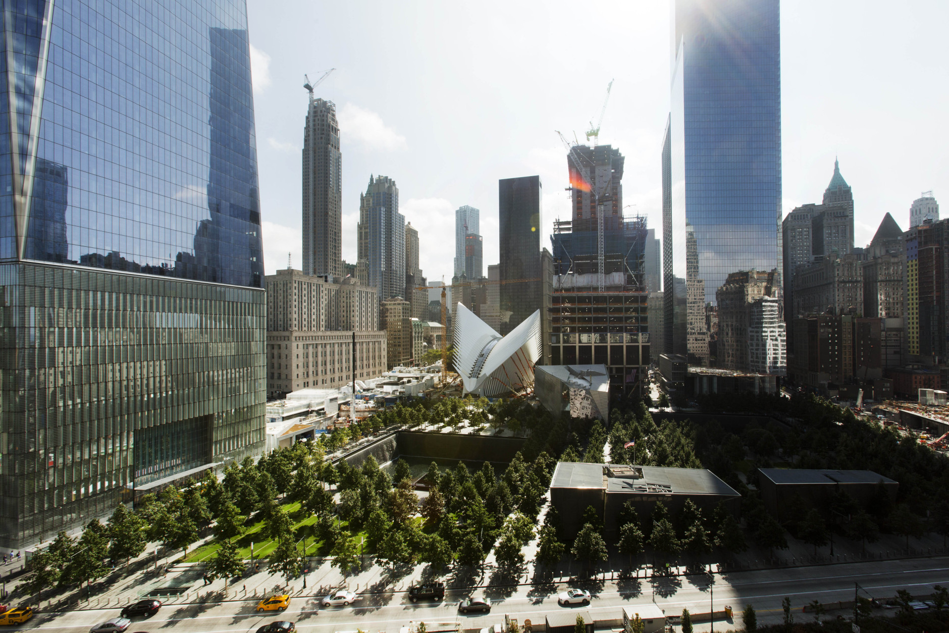 This Wednesday, Sept. 9, 2015 photo shows the National September 11 Memorial and Museum, center foreground, surrounded by One World Trade Center, left, the white v-shaped transportation hub, center, and 4 World Trade Center, the tall building at right, in New York. The building under construction at center right is 3 World Trade Center. Friday will mark the 14th anniversary of the Sept. 11 terrorist attacks on the United States. (AP Photo/Mark Lennihan)