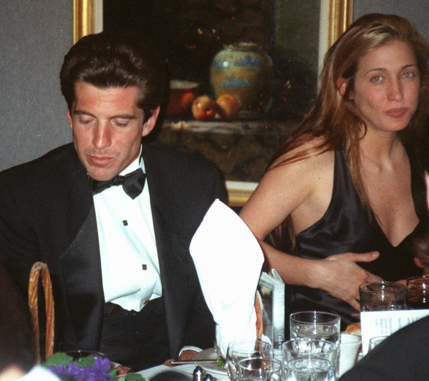 In 1996, John F. Kennedy Jr. married Carolyn Bessette in a secret ceremony on Cumberland Island, Georgia. Here, John F. Kennedy, Jr., and Carolyn Bessette dine at the National Arts Club in New York in this March 1995 file picture. (AP Photo/Aubrey Reuben)
