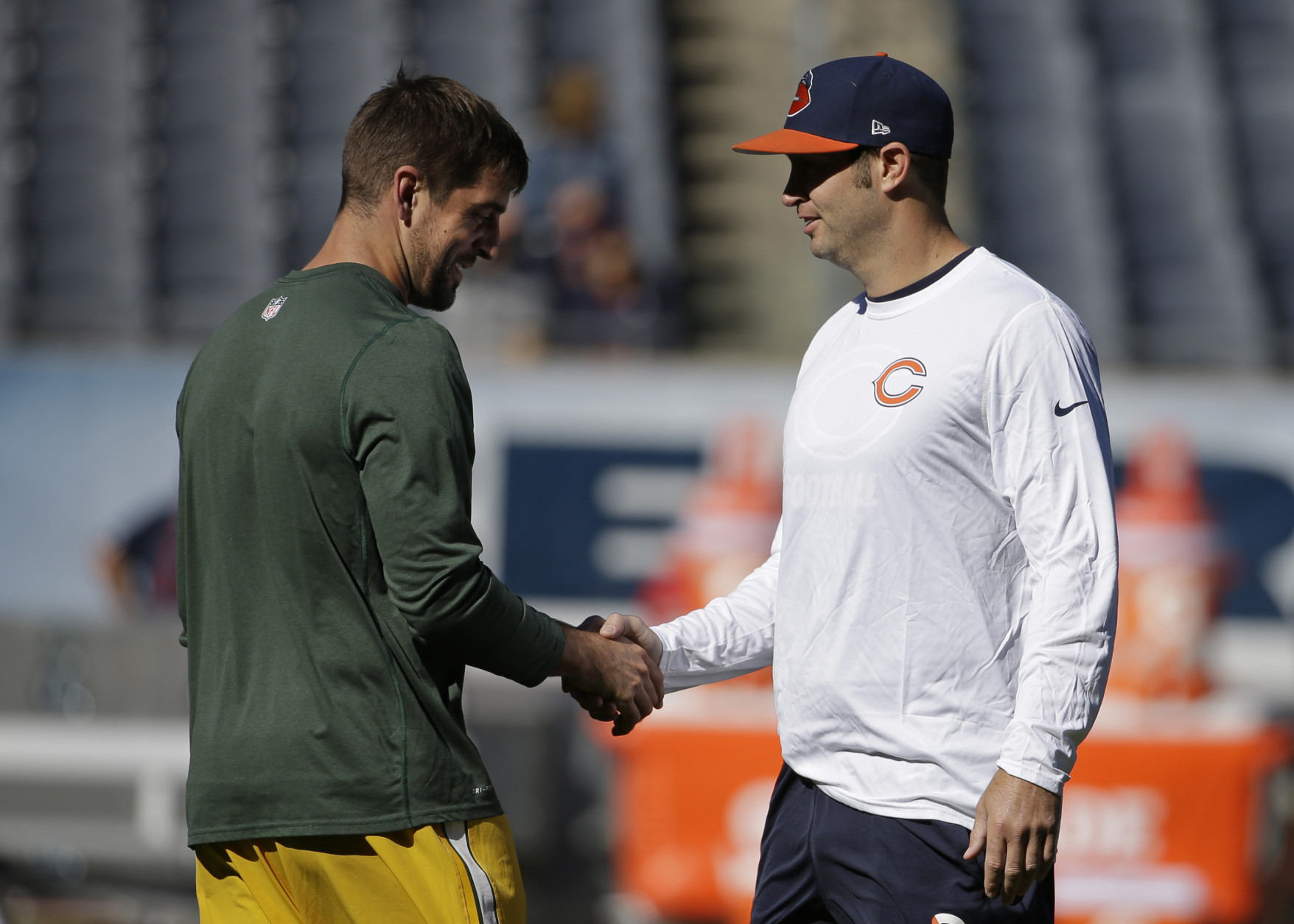 Green Bay Packers quarterback Aaron Rodgers, left, and Chicago Bears quarterback Jay Cutler greet each other before their NFL football game, Sunday, Sept. 13, 2015, in Chicago. (AP Photo/Nam Y. Huh)