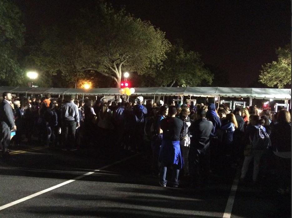 Crowds line up at the perimeter at 18th and Constitution to see Pope Francis at about 4 a.m. Thursday, Sept. 23, 2015. (WTOP/Nick Iannelli)