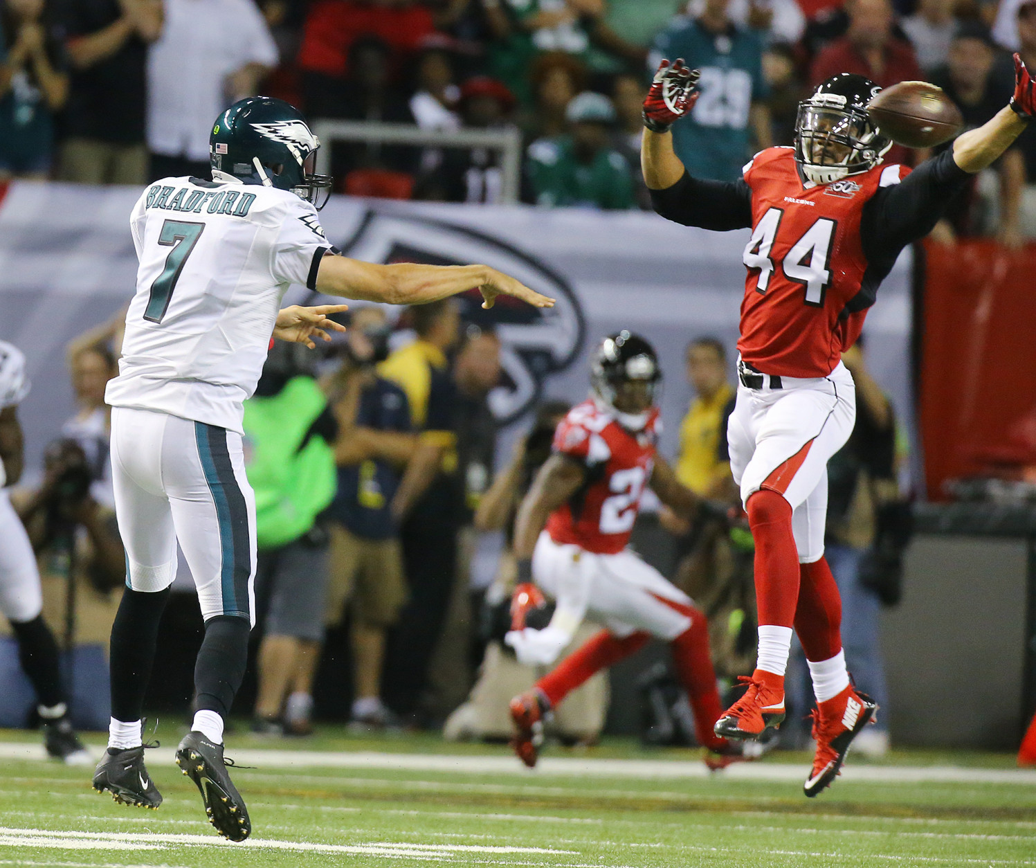 Falcons Vic Beasley Jr. just misses blocking a pass by Eagles quarterback Sam Bradford during an NFL football game on Monday, Sept. 14, 2015, in Atlanta. (Curtis Compton/Atlanta-Journal Constitution via AP) MARIETTA DAILY OUT, GWINNETT DAILY POST OUT, LOCAL TV OUT (WXIA, WGCL, FOX 5)