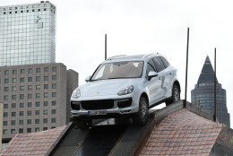 A Porsche Cayenne drives on a SUV show track on the first press day of the Frankfurt Auto Show IAA in Frankfurt, Germany, Tuesday, Sept. 15, 2015. The car show runs through Sept. 27. (AP Photo/Jens Meyer)