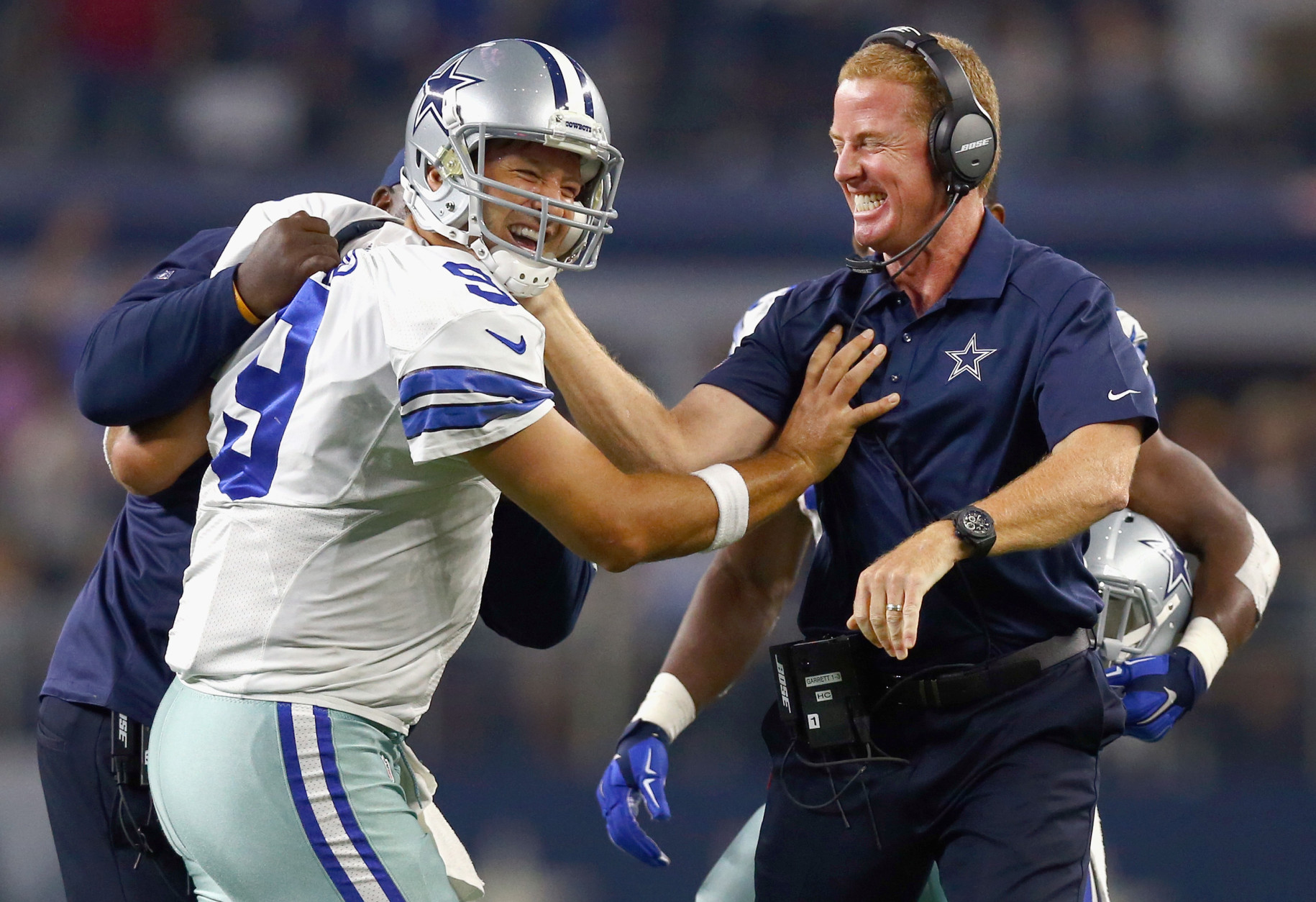 ARLINGTON, TX - SEPTEMBER 13:  Tony Romo #9 of the Dallas Cowboys celebrates with head coach Jason Garrett of the Dallas Cowboys after scoring the game winning touchdown against the New York Giants at AT&T Stadium on September 13, 2015 in Arlington, Texas.  (Photo by Tom Pennington/Getty Images)