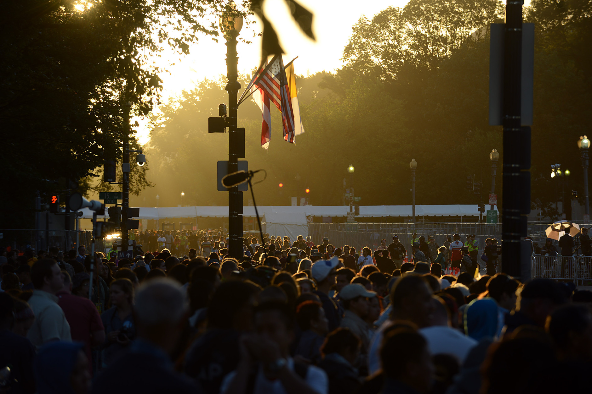 WASHINGTON, DC - SEPTEMBER 23: Hundreds of spectators pass through a security check as early as 5 am along the parade route of pope Francis around the Ellipse, south of the White House, September 23, 2015  in Washington, DC. People are gathering near the Ellipse to catch a glimpse of Pope Francis, where he is due to be greeted by President Obama during an official arrival ceremony. (Photo by Astrid Riecken/Getty Images)